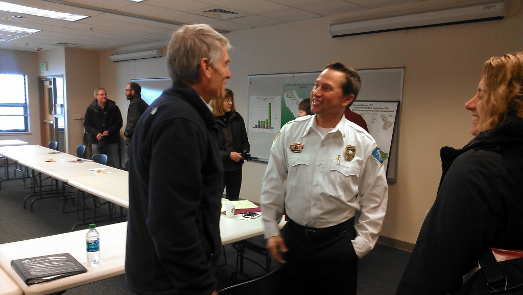 U.S. Sen. Mark Udall, left, chats with LDFR Deputy Chief Jeff Berino about wildfire policy and legislation at a roundtable meeting in Frisco on 9 February 2014.